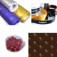 Gift wrapping papers, ribbons and rosettes